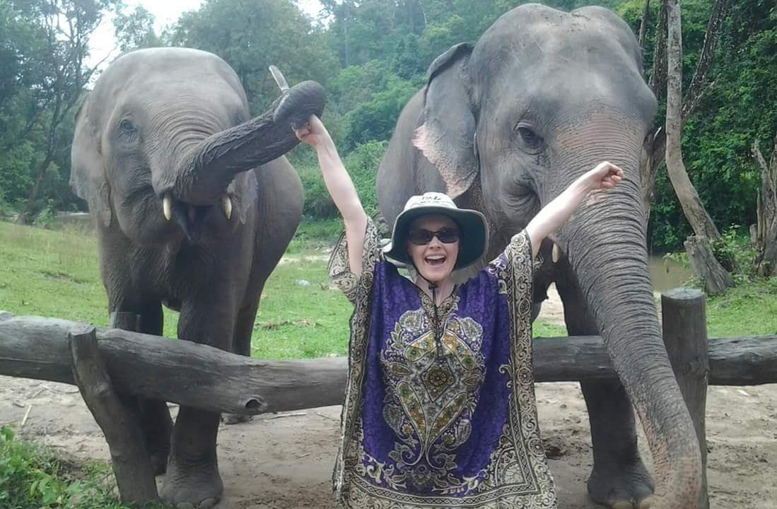 Cassandra Kubinski with elephants in Thai Jungle