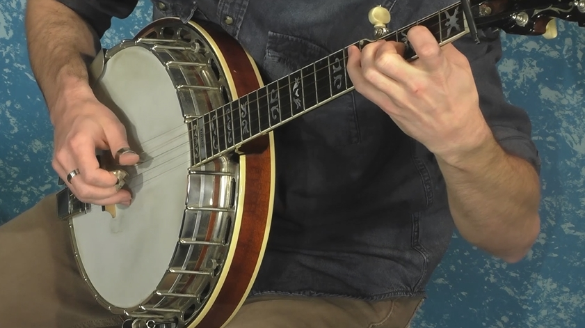 Wilson Harwood performing with his banjo on Alive with Clive