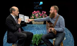Jason Moore points to his vinyl recordings on Alive with Clive