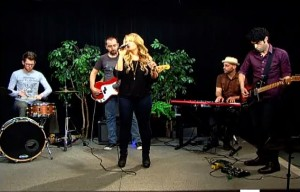 Leslie DiNicola performing with her band on Alive with Clive